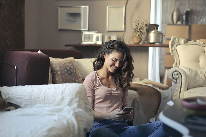 woman enjoying using her second number and eSIM at home