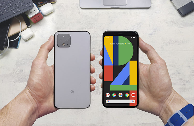 user holding a google pixel 4 esim enabled device in their hands