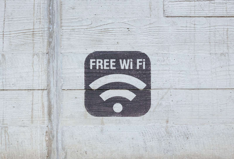 free wi-fi sign painted on wall