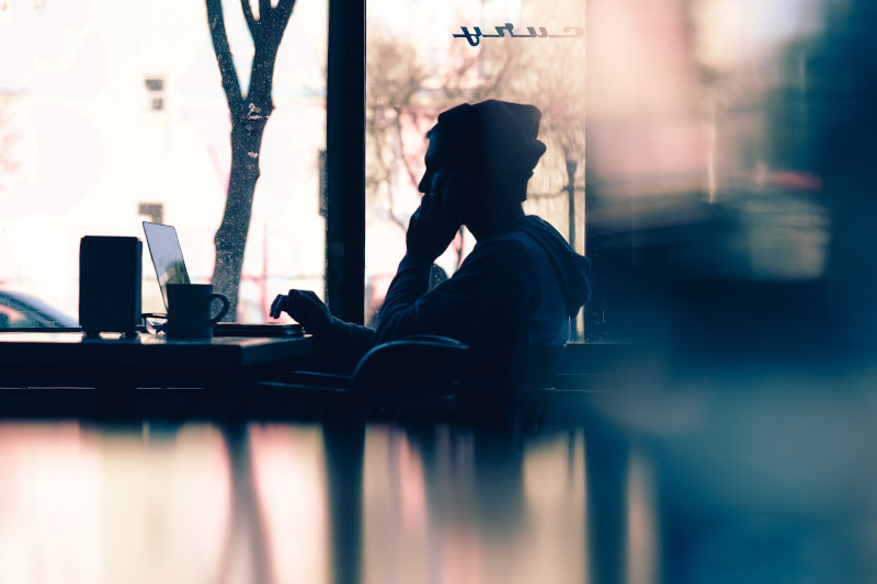 person making Wi-Fi call in coffee shop