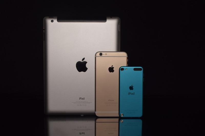 eSIM iPad and phones against black background